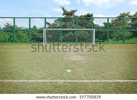 A soccer goal post with the six yard penalty spot, on a green soccer arena. - stock photo