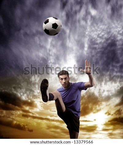 a soccer player and a sunset - stock photo