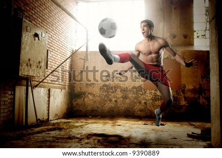 a soccer player in a old hovel - stock photo