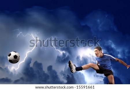 a soccer player in acrobatics and a storm - stock photo