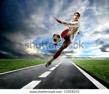 a soccer player on the street - stock photo