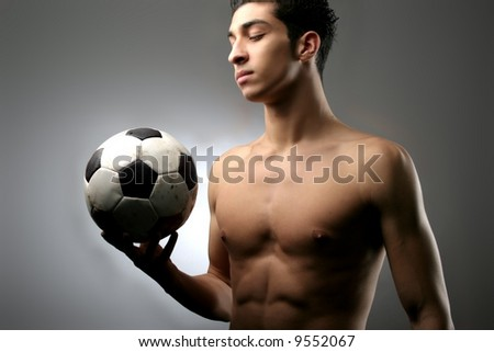 a soccer player with a ball - stock photo