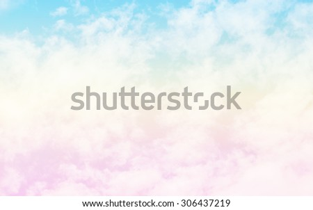 A soft cloud background with a pastel colored orange to blue gradient. - stock photo