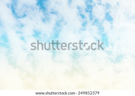 A soft cloud background with a pastel colored orange to blue gradient.retro vintage tone. - stock photo