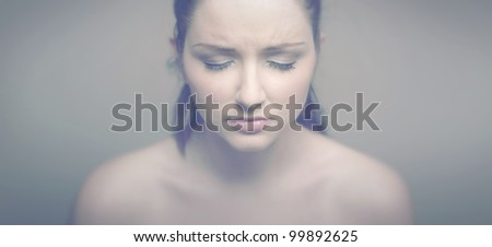 A soft vintage panoramic portrait of a sad woman. - stock photo