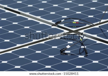 a solar panel installation with cables showing - stock photo