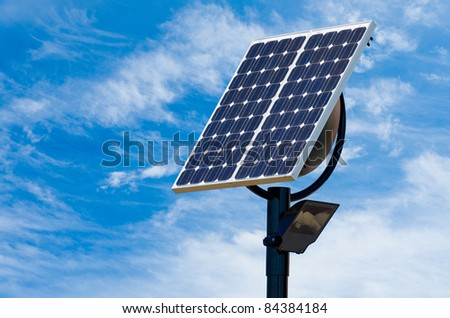 A Solar Panel on a Pedestal on a Blue Sky