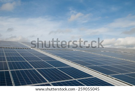 a solar panel or photovoltaic modules with a cloud background for renewable energy - stock photo