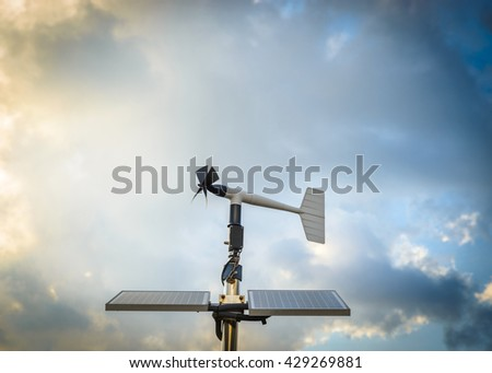A solar powered anenometer against a dramatic stormy sky - stock photo