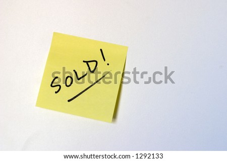 A sold yellow sticky note on a white background - stock photo