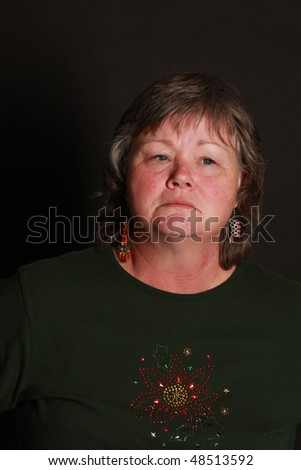 a sorrowful looking lady staring off camera - stock photo