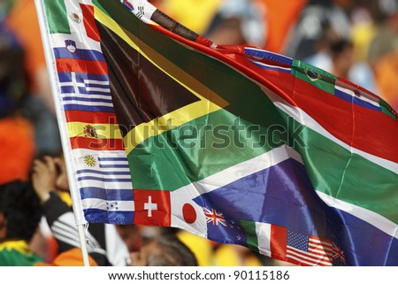 A South Africa flag bordered by various participating country flags of the 2010 World Cup. - stock photo