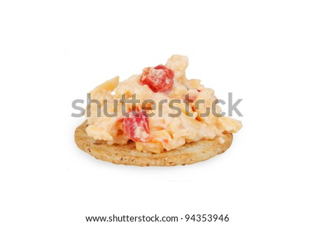 A Southern favorite...pimiento cheese spread on a cracker.