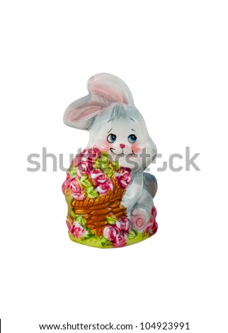 a souvenir a porcelain young hare holds basket of roses