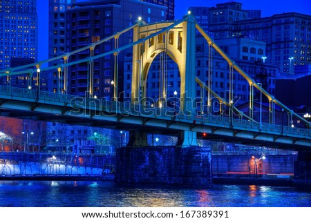 A span of the Roberto Clemente Bridge over the Allegheny River in downtown Pittsburgh, Pennsylvania at night. - stock photo