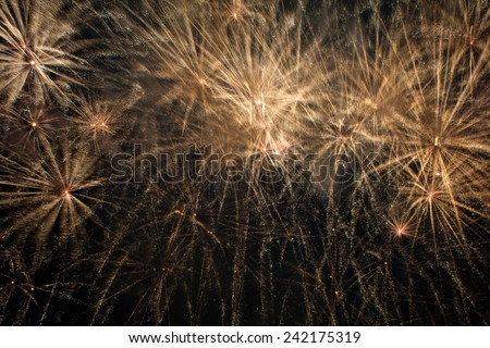 A Spark and big explosion in black background - Computational graphic, Fireworks light up the sky with dazzling display, big explosion in fog, golden fireworks, fireworks in Malta - stock photo