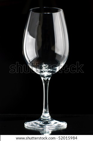 A sparkling wine glass isolated on a black background