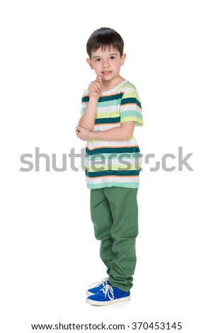 A speaking little boy shows his finger forward - stock photo