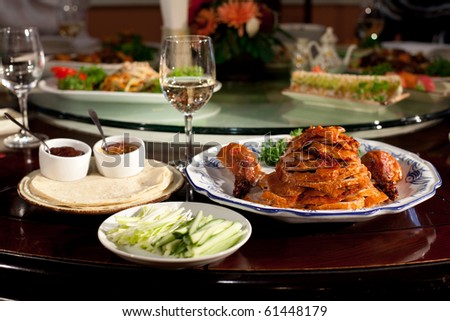 A special emperor meal of peking duck at a special dinner party - stock photo