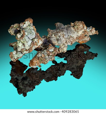 A specimen of crystalline copper heavily encrusted with cupric oxide from the upper peninsula of Michigan.  Large copper crystals on the underside may be seen in the image's reflection.