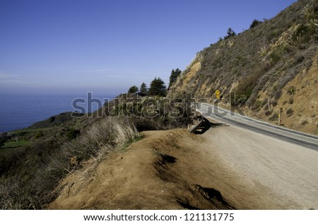 A spectacular view of mountain and ocean along California's Highway 1. - stock photo