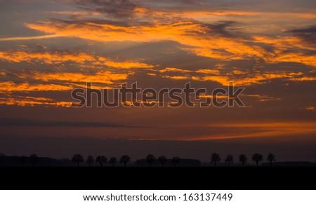 A spectacular, vivid sky at sunset. rural landscape - stock photo