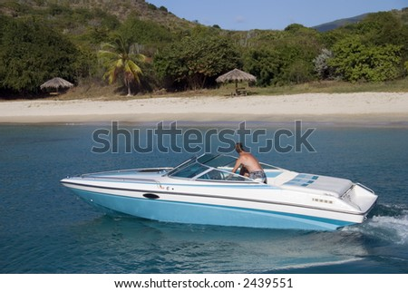 A speedboat in the Caribbean. - stock photo