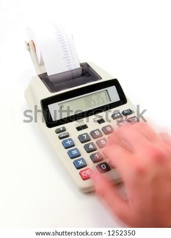A speedy hand running a calculator very hard.  Deep DOF. - stock photo