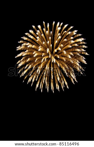 A spherical break of stars. Firework rocket. Isolated on a black background. - stock photo