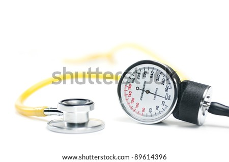A sphygmomanometer and stethoscope on white. healthcare concept. Shallow DOF. - stock photo