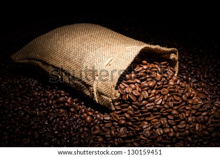 a spilled coffee bag in spotlight - stock photo