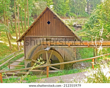 A spinning mill wheel. - stock photo