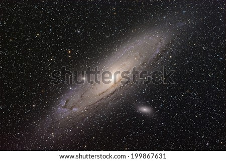 A spiral galaxy approximately 2.5 million light-years from Earth in the Andromeda constellation. Also known as Messier 31, it is the largest galaxy of the Local Group of galaxies. - stock photo