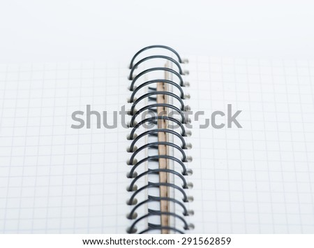 A spiral notebook over the white background
