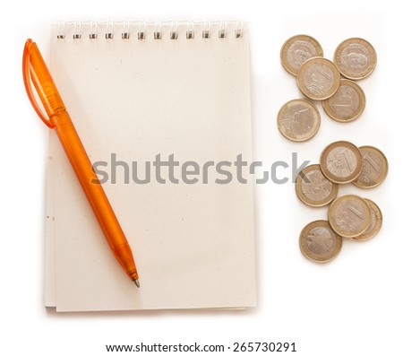 A spiral notebook with a place for text, a pen and some euros on white background - stock photo