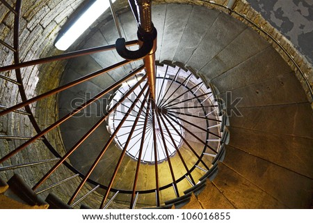 A spiral staircase in old tower going up - stock photo