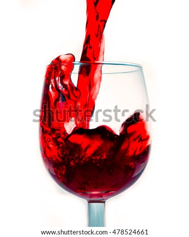 A splash into the glass of wine
