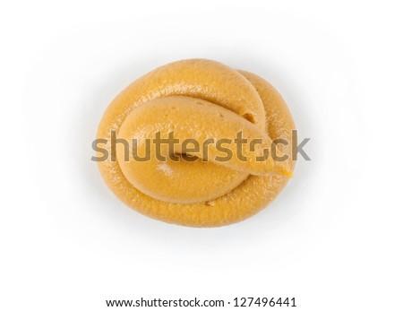 a splotch of mustard on white background - stock photo