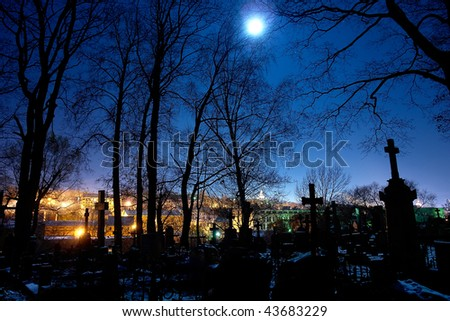 A spooky graveyard at night - stock photo
