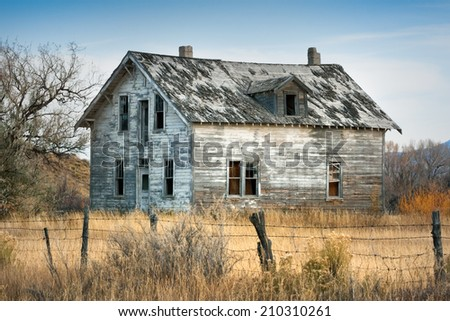 A spooky-looking old house in rural Wyoming. - stock photo