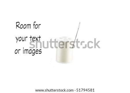 a spool of white thread with a needle isolated on a pure white background - stock photo