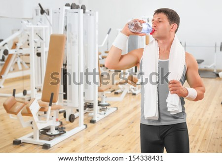 a sportsman drinking water from bottle - stock photo
