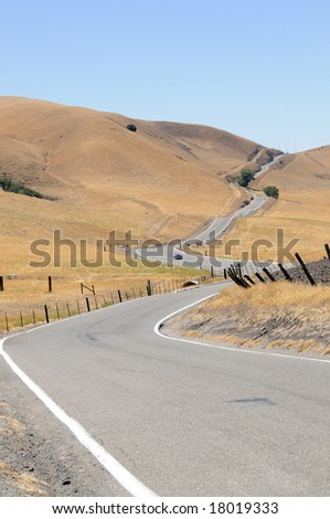 A sportster negotiating a  long winding country road in California - stock photo