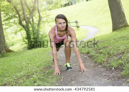 A sporty woman running outdoors in park