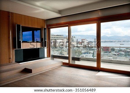 a spot in a wooden modern loft and expensive living room with view - stock photo
