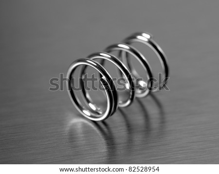 A spring isolated against a silver background - stock photo