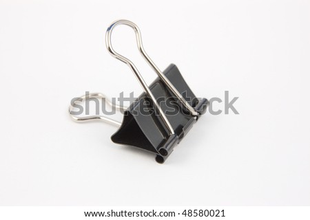 A spring loaded document clip - stock photo