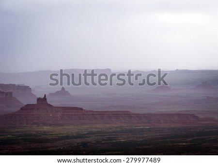 A spring rain on the Valley of the Gods in southern Utah. - stock photo