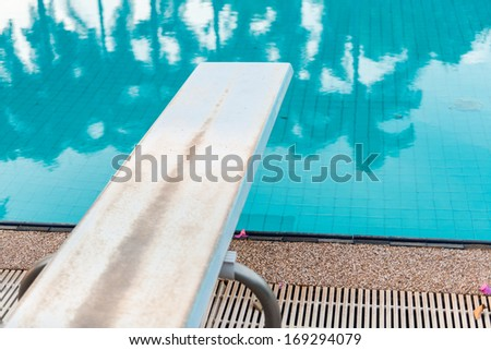 A Springboard to dive at swimmingpool - stock photo