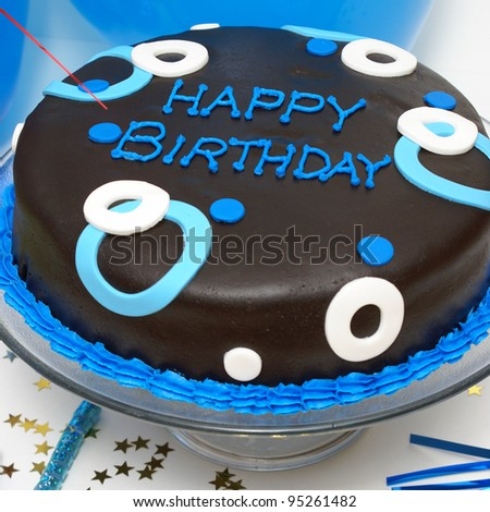 A square format shot of a birthday cake for any males special day. - stock photo